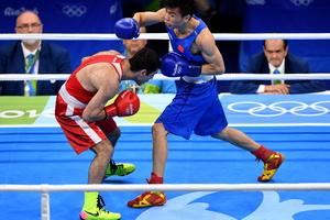 男子52公斤级:胡建关获铜牌