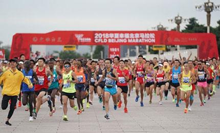 """专访王楠:北京马拉松为何能成为""""国马""""?"""